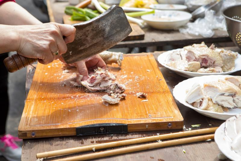 China, religious beliefs, sacrifices, chicken. Chinese traditional religious beliefs, devout believers help prepare sacrifices for ceremonies, lick chicken stock photography