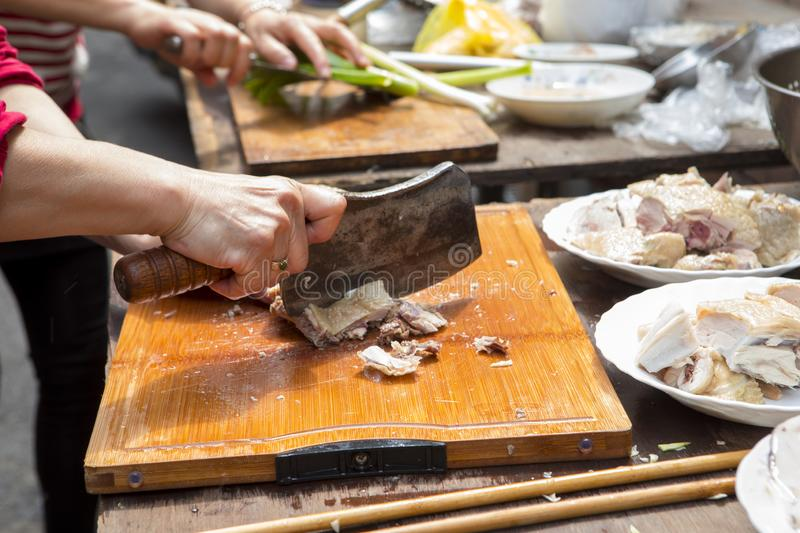 China, religious beliefs, sacrifices, chicken. Chinese traditional religious beliefs, devout believers help prepare sacrifices for ceremonies, lick chicken royalty free stock photos