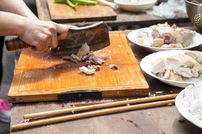 China, religious beliefs, sacrifices, chicken. Chinese traditional religious beliefs, devout believers help prepare sacrifices for ceremonies, lick chicken royalty free stock image