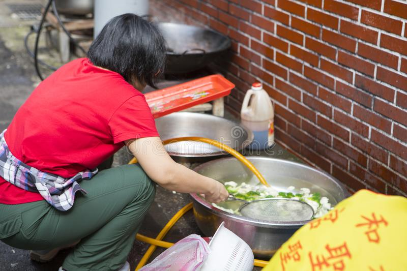 China, religious beliefs, sacrifices, cleaning vegetables. Chinese religious beliefs, devout believers prepare sacrifices for ceremonies, clean vegetables royalty free stock photos