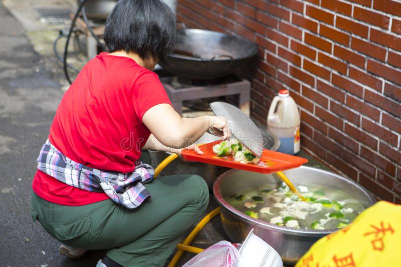 China, religious beliefs, sacrifices, cleaning vegetables. Chinese religious beliefs, devout believers prepare sacrifices for ceremonies, clean vegetables royalty free stock images