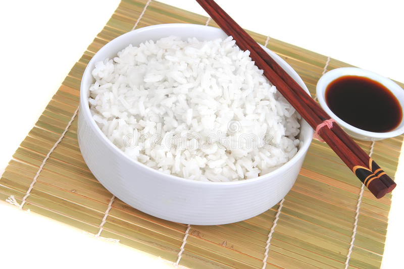 China rice on traditional bamboo mat royalty free stock images