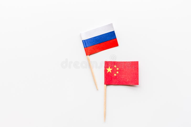 China-Russia relations. Country cooperation. Russian and Chinese flags on white background top view copy space. Flat lay, overhead stock photography
