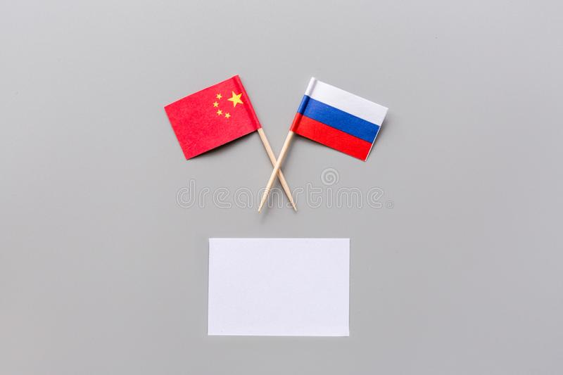 China-Russia relations. Country cooperation. Russian and Chinese flags on white background top view copy space. Flat lay stock photos