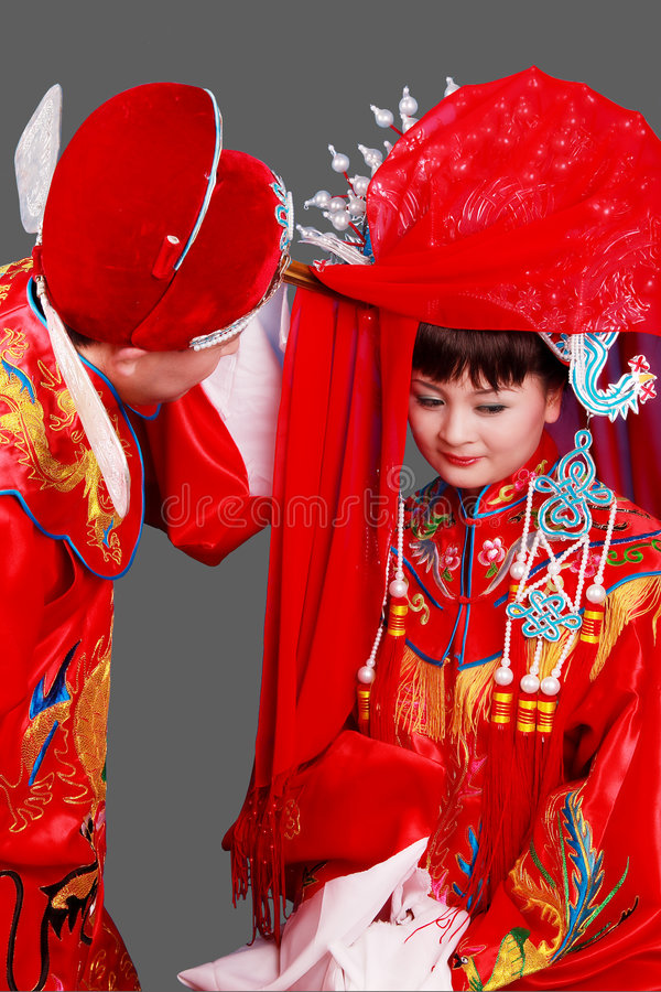 China's ancient wedding. Newly-married couple on China's ancient traditional wedding,This kind of wedding includes very deep Chinese traditional culture color royalty free stock photos