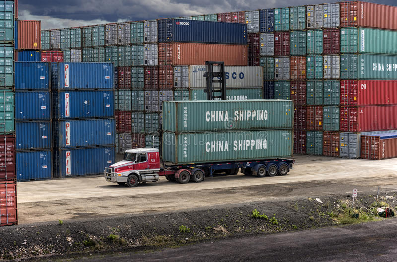 China Shipping containers at Port Botany. A semi-trailer truck is double stacked with China Shipping containers stock photos