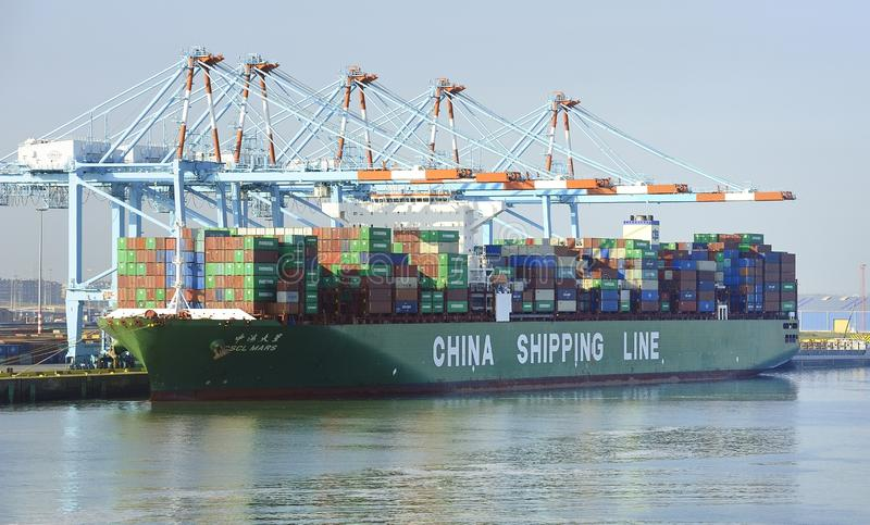 China Shipping Line CSCL Mars container ship taking on the cargo. Zeebrugge, Belgium - 29th April 2019: China Shipping Line CSCL Mars container ship taking on royalty free stock photo