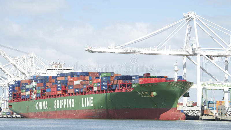 China Shipping Lines Cargo Ship XIN MEI ZHOU loading at the Port stock photography