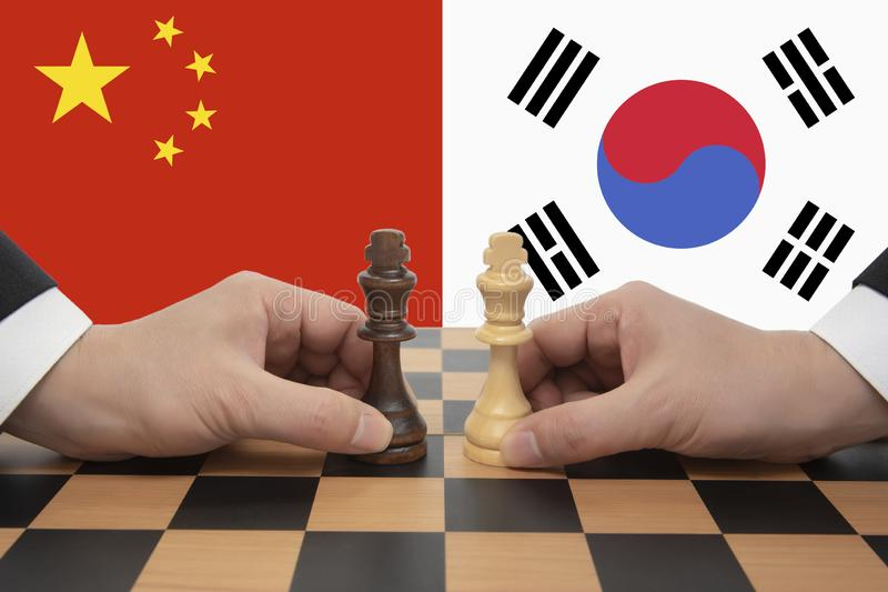 China-South Korea Summit expressed in a chess game. royalty free stock image