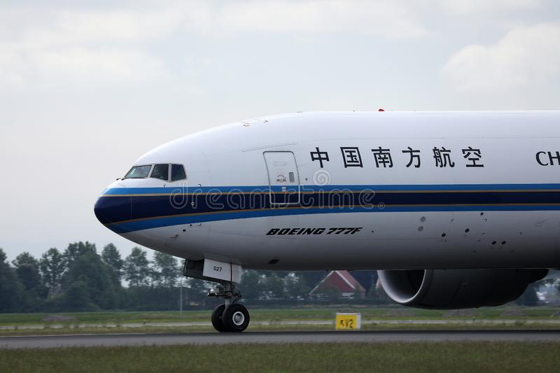 China Southern taxiing on Schiphol Airport, AMS, close-up view. China Southern doing taxi on Amsterdam Schiphol Airport, AMS, Netherlands. Boeing B777 royalty free stock photography