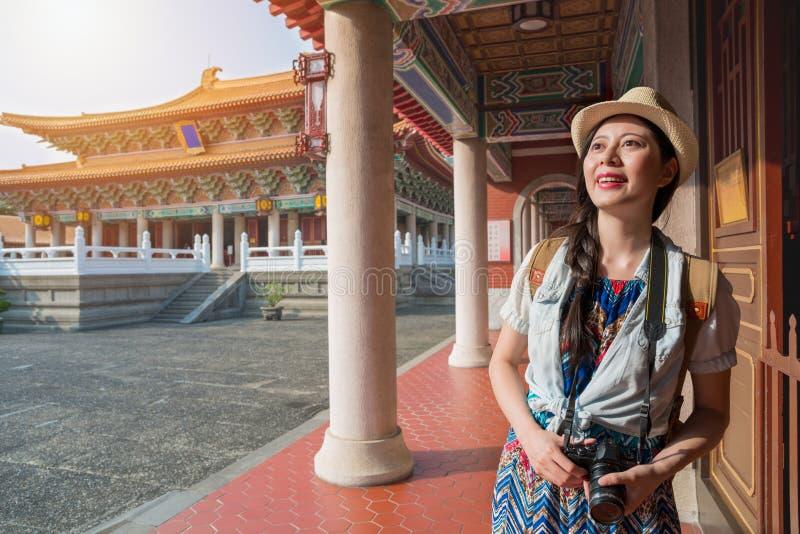 Beautiful Asian woman tourist relaxing looking stock image