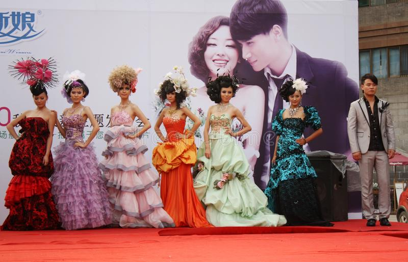 China Wedding Fashion and hairstyle parade. Wedding Fashion and hairstyle parade of young chinese designers at the Central square of Xian, China July 25, 2010 royalty free stock photo