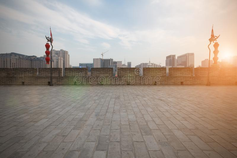 China `s Xi`an city walls and new buildings stock photo