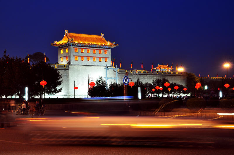 China xi 'an ancient city wall at night. China's xian city wall is located in the central shaanxi xi 'an, rectangular, wall is 12 meters high, 18 meters wide royalty free stock photography