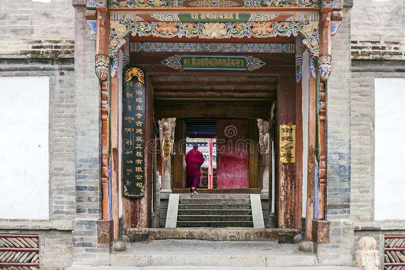 Monk Is Walking Into The Tibetan Temple stock images