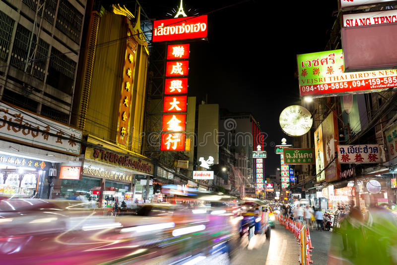CHINATOWN, BANGKOK, THAILAND - Apr 27, 2017: At China Town bangkok cars light trail. And shops and a lot off people at night time royalty free stock photography