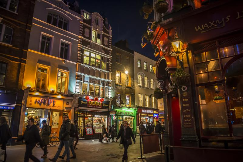 Chinatown full of restaurants and shops at night in central London, England, UK stock images