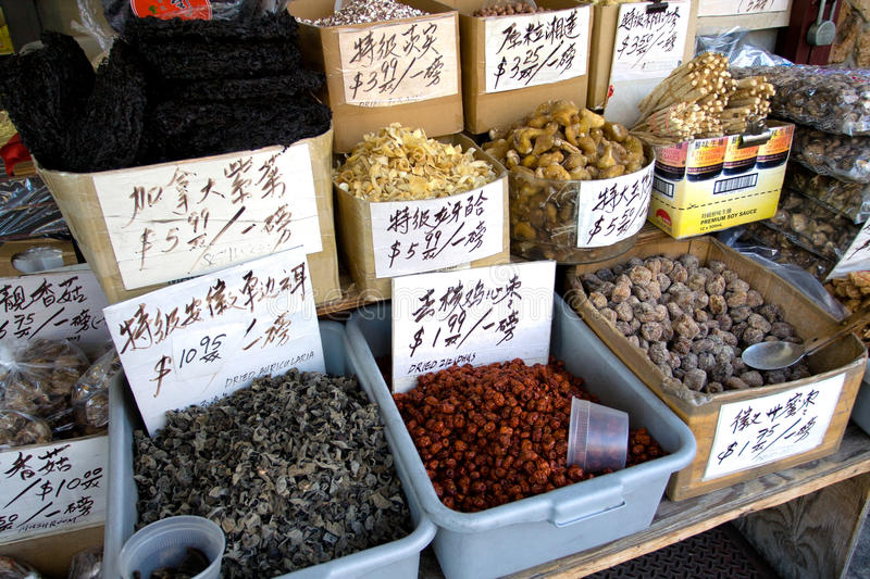 Chinatown green market. Green market roots, dried fruits, mushroom and vegetables. New York, Chinatown stock photos