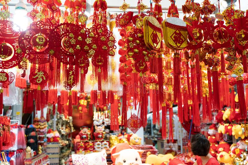 Traditional merchandise and decorations on a market in Chinatown Singapore before Lunar New Year celebration royalty free stock photos