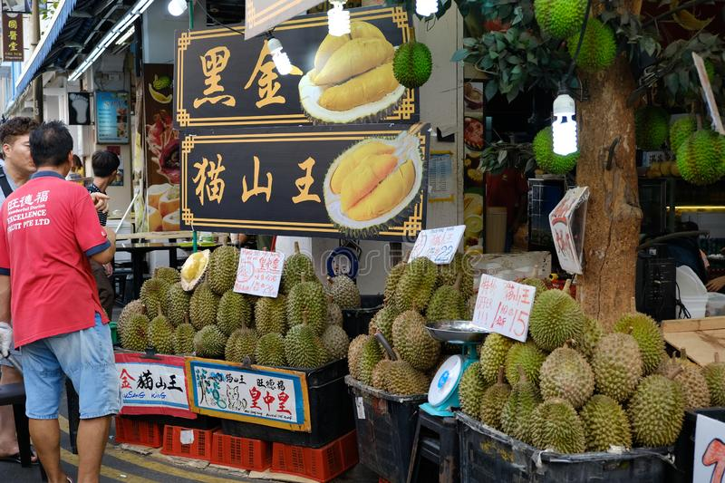 Chinatown, Singapore - March 8, 2019 : Man selling durian on chinatown market stock photography