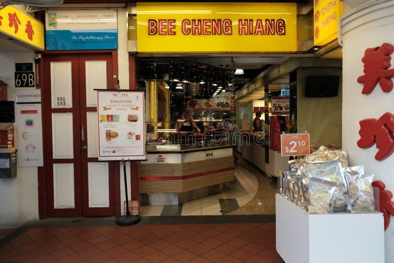 Chinatown, Singapur - 8 de marzo de 2019: La abeja Cheng Hiang asó la tienda de los pedazos del cerdo en Chinatown foto de archivo