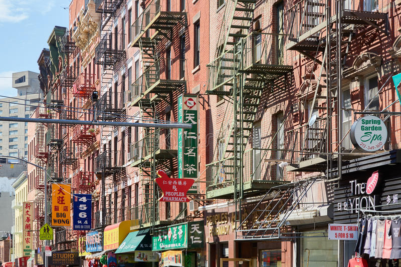 Chinatown street and buildings with stairs and signs in New York. NEW YORK - SEPTEMBER 7: Chinatown street and buildings with stairs and signs in a sunny day on stock photo