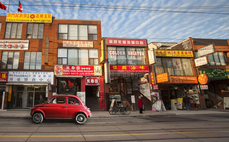 Chinatown in Toronto (Canada) and old vintage red Italian Car. Chinatown in Toronto (Canada). Panorama Wide with Chinese shops and businesses in the historic royalty free stock photography