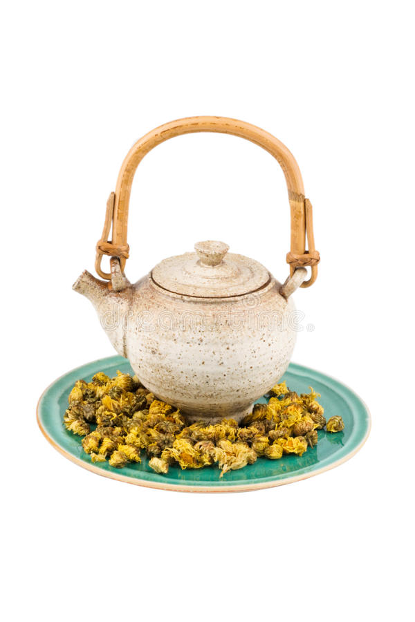 Chinaware And Tea Kettle. Tea Kettle Display isolated on a white background with chrysanthemum tea stock photography