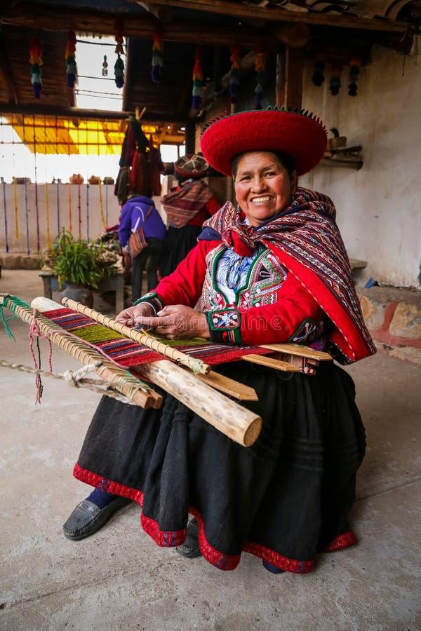 CHINCHERO, PERU - July 13, 2018. Weaving woman, hand-made colorful materials royalty free stock photo