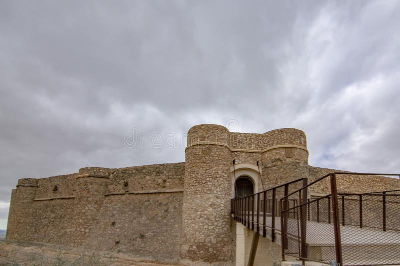 Castle of Chinchilla de Montearagon, province of Albacete, Spain. Chinchilla de Montearagon, Albacete, Spain; February 2017: Gate of castle of Chinchilla de stock photography