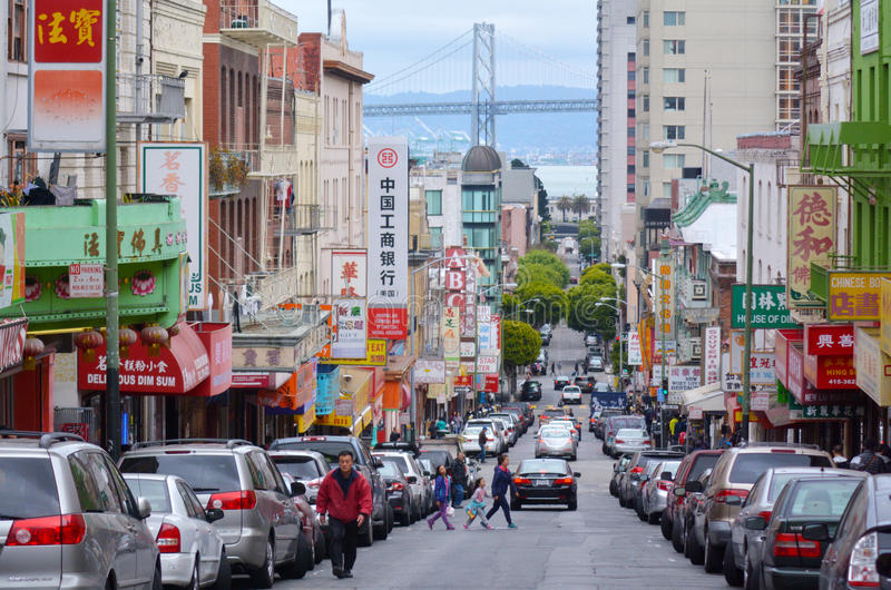 Chines people and Oakland bay bridge as seen from Chinatown in S stock photos