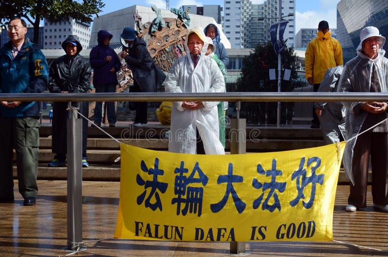 Chines people practicing Falun Dafa in Aotea Square in Auckland. AUCKLAND - SEP 03 2015:Chines people practicing Falun Dafa in Aotea Square. It's a Chinese royalty free stock photo