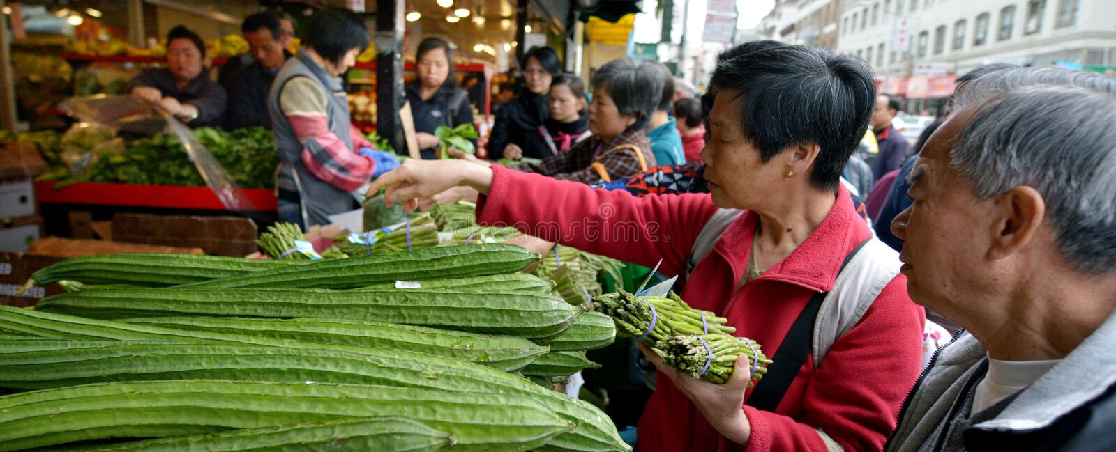 Chines people are shopping in a food market in Chinatown San Francisco California. SAN FRANCISCO - MAY 19 2015:Chines people are shopping in a food market in royalty free stock photos