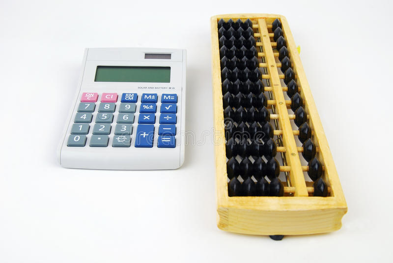 Chinese Abacus and modern calculator stock photography
