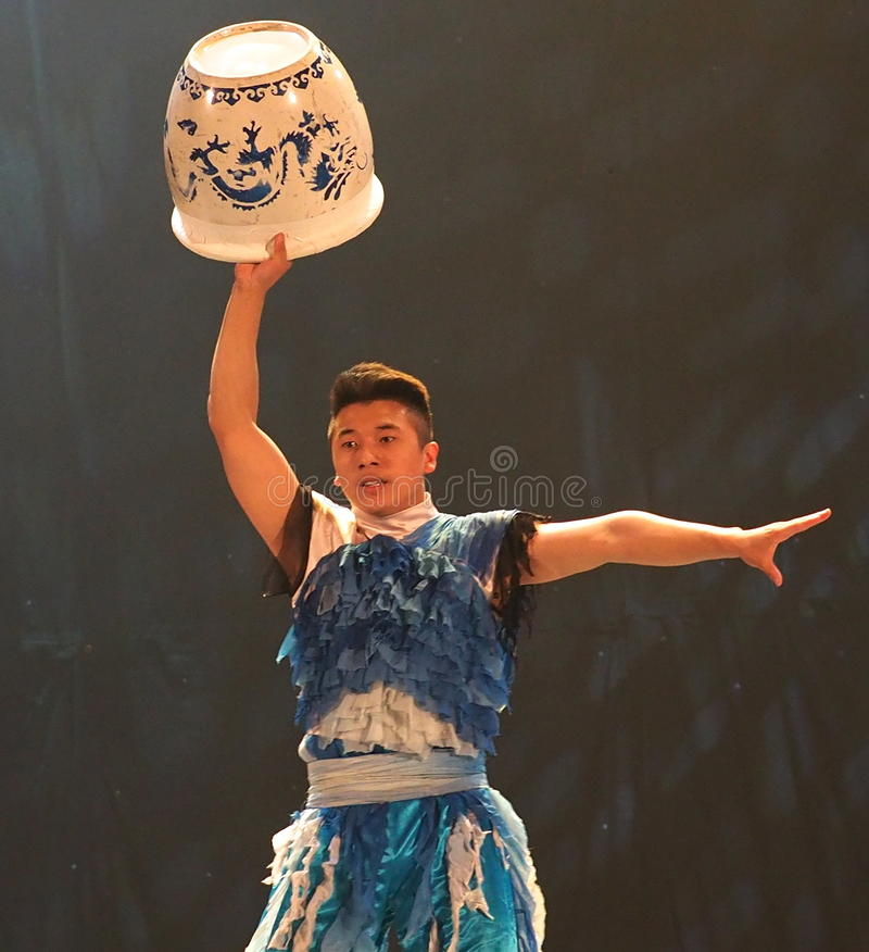 Chinese Acrobat With Clay Pot royalty free stock photos