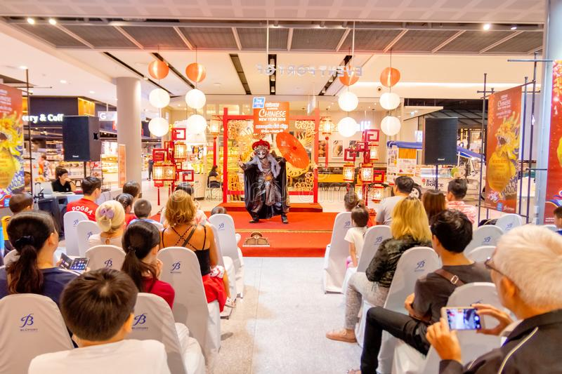 Chinese actor in the mask performing the magic tricks to the customer who shopping in the Bleport shopping mall celebrating stock images