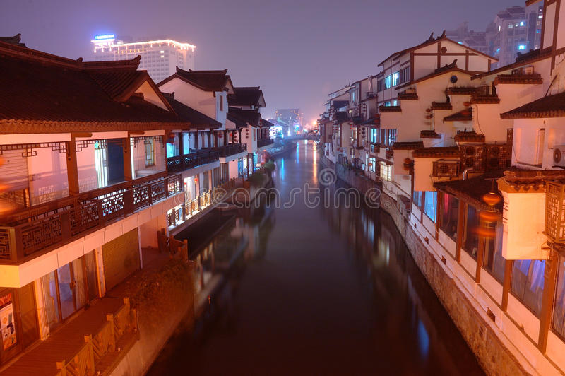 Chinese ancient town. It is an ancient town in Wuxi city, China. It is beautiful in the evening with the reflection of the building in the river royalty free stock photography