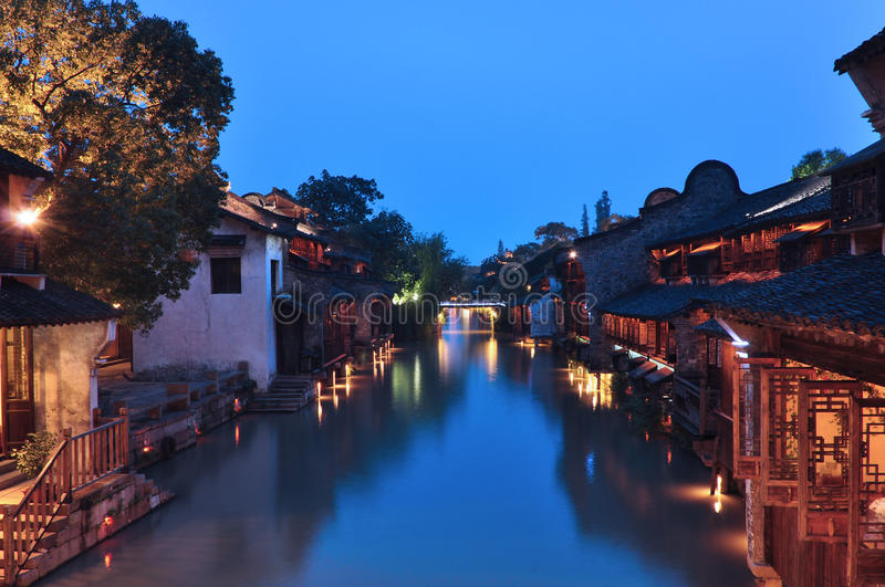 Chinese ancient town at night. The buildings nearby the river are so old but really beautiful stock photo