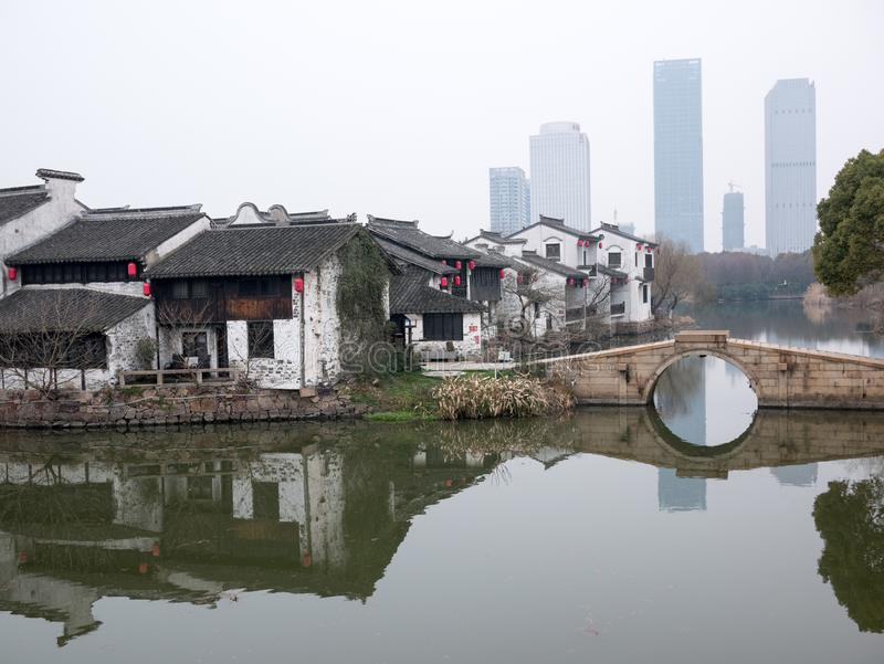 Chinese ancient town xuntang wuxi stone bridge water. Chinese ancient town xuntang wuxi stone bridge and small river. The house is reflected in the water stock photography
