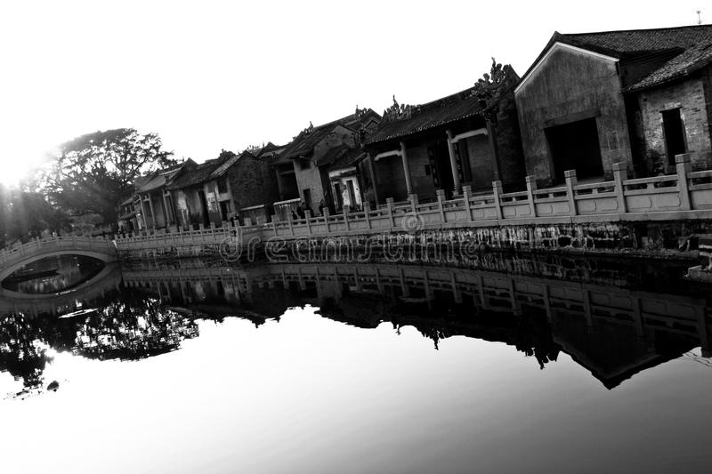 Chinese ancient village along a river royalty free stock photo