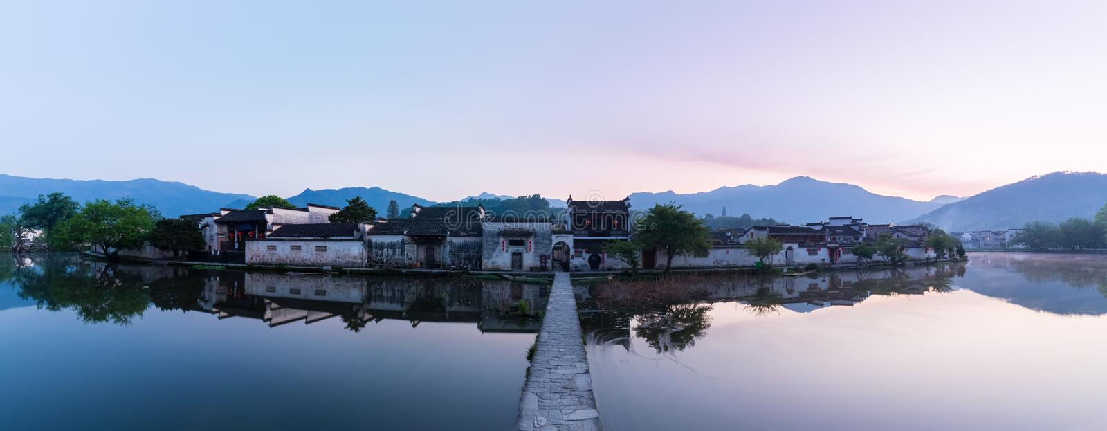 Chinese ancient villages in dawn. A panoramic view of ancient villages in dawn, beautiful hongcun in the chinese paintings royalty free stock photo