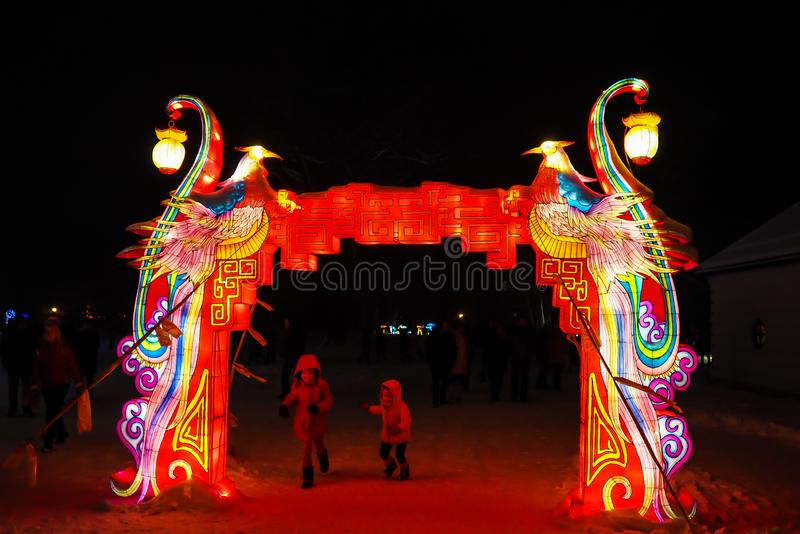 Chinese arch with lanterns. Pakruojis, Lithuania - The festival of large Chinese lanterns in Pakroya Manor, large colorful installations, Chinese arch with stock photos