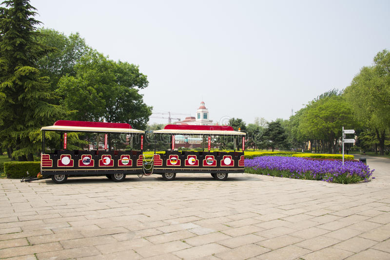 Chinese Asia, Beijing, the World Park,The gardening landscape,A small tourist train. China Asia, Beijing, the world park, the famous historic sites and stock image