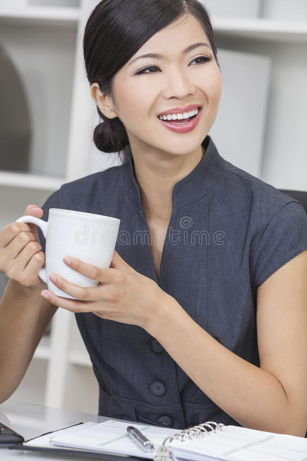 Chinese Asian Woman Businesswoman Drinking Stock Image