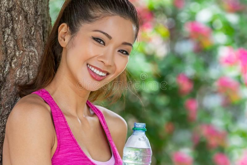 Chinese Asian Young Woman Girl After Sport Drinking Bottle of Water stock image