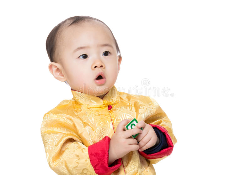 Chinese baby boy with toy block. Isolated on white stock image