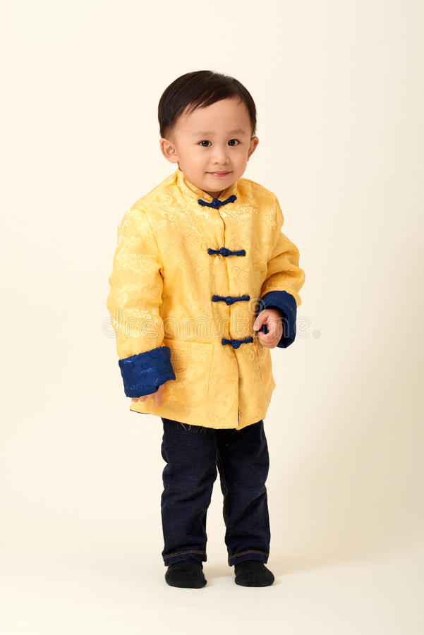Chinese baby boy in traditional Chinese New Year outfit royalty free stock photo