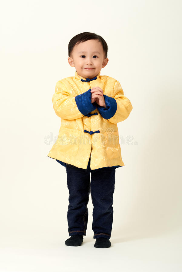 Chinese baby boy in traditional Chinese New Year outfit stock image