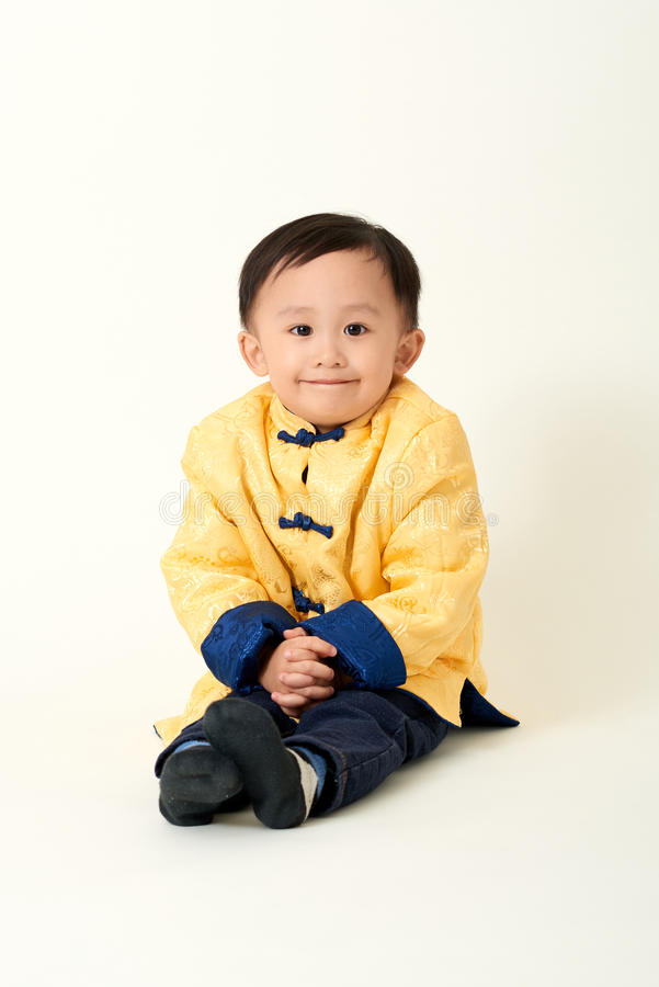 Chinese baby boy in traditional Chinese New Year outfit royalty free stock photography