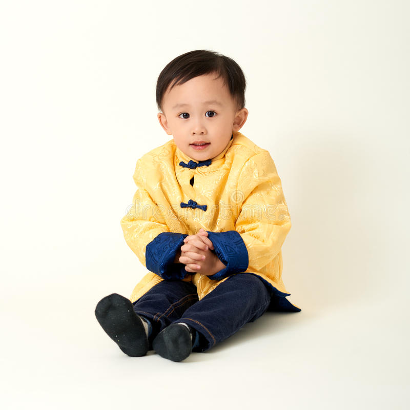 Chinese baby boy in traditional Chinese New Year outfit royalty free stock photos
